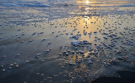 filming point of view: winter sunset, over icy surface, crystallization