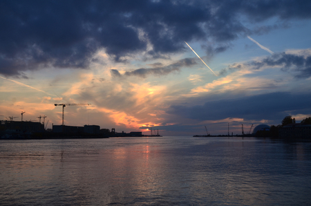 urban sprawl: access to sea, city outskirts at sunset