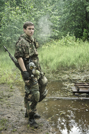 guerilla warfare: soldiers in forest, thematic shooting war and Stalker Stock Photo