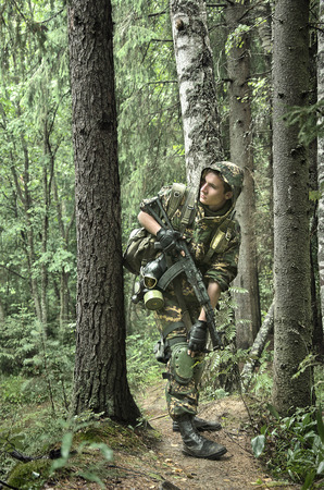 guerilla: soldiers in forest, thematic shooting war and Stalker Stock Photo