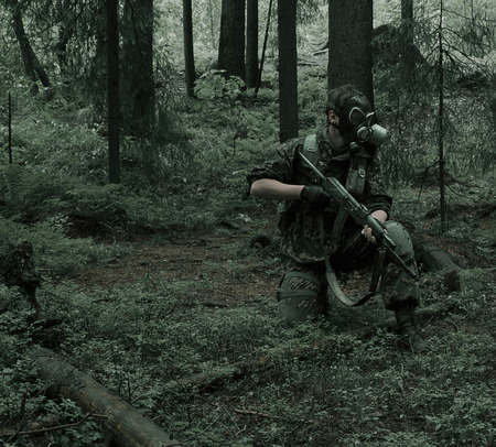stalker: soldiers in forest, thematic shooting war and Stalker Stock Photo