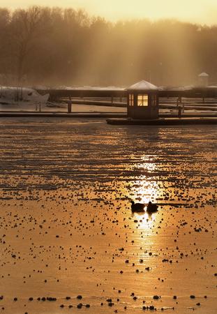 frozen river: sunset over a frozen river Stock Photo
