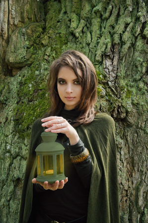Samhain witch with a lantern, the image embodies the witch or elf. Fantasy