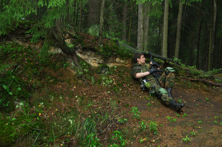 militarily: soldier, military staged photography in forest Stock Photo