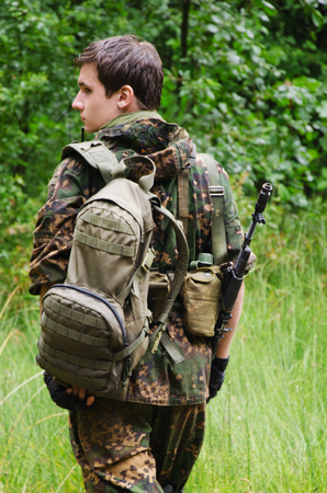 duffel: soldier, military staged photography in forest Stock Photo