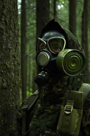 militarily: In Gas Mask, military staged photography in forest
