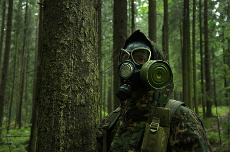 In Gas Mask, military staged photography in forest