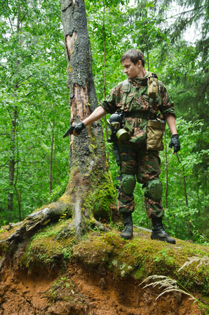 militarily: soldier in forest, military staged photography Stock Photo