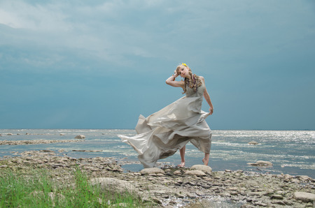allusion: gown of silver parachute silk necklace of shells and pearl gold jewelry. Wind storm. An allusion to the Scandinavian and Celtic mythology.