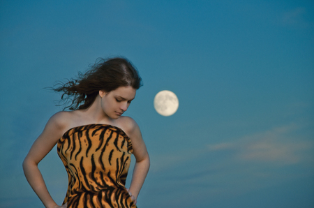 waxing gibbous: girl with long hair in moonlight