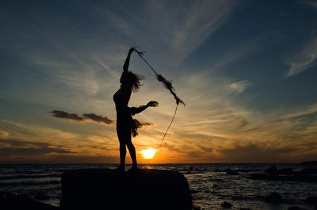 throw cushion: girl catching sun, girl on the shore Stock Photo