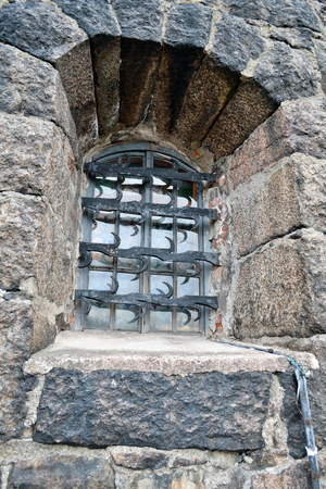fortified wall: window with iron bars, old fort wal Stock Photo