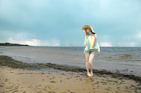 sand beach: woman and beach before the storm Stock Photo