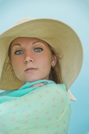 lass: face of woman, isolated on blue color Stock Photo