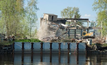house demolition: destruction of old building, house demolition with bulldozer Stock Photo