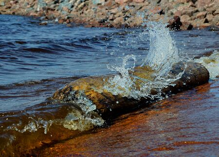 storm tide: surf wave on beach Stock Photo