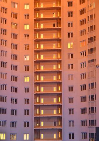 many windows: apartment house, many windows on the wall