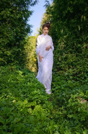 southeast asian ethnicity: Beautiful Oriental woman walks in garden