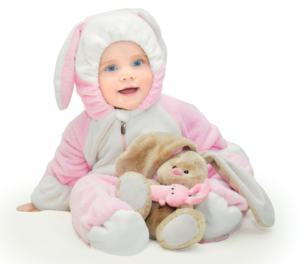 cheesy grin: happy little girll in a pink bunny suit - isolated image