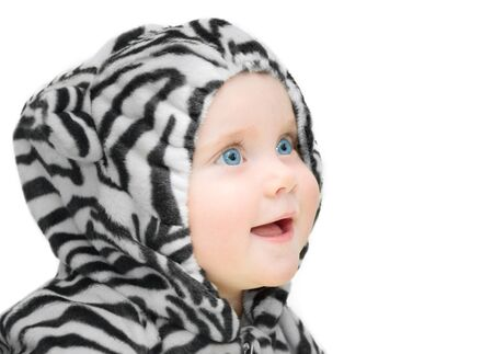 cheesy grin: happy little girl in a striped suit - isolated image