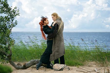 tales of north, couple in fantasy costumes on the beach