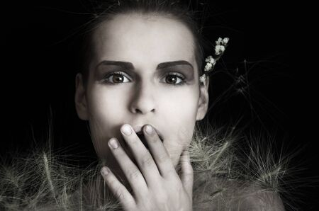 suddenness: Portrait of a young woman with a bouquet on a black background Stock Photo