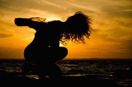 womans silhouette and sunset