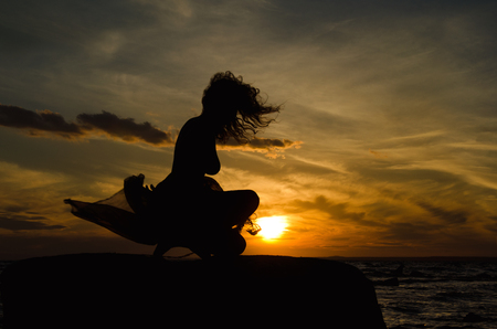 woman's silhouette and sunset