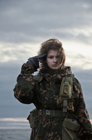militant: military style, woman and pistol