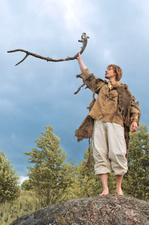 druid causes the rain raising his staff to the heavens Stock Photo