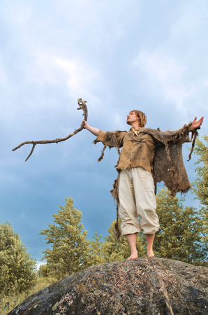 druid causes the rain raising his staff to the heavens 写真素材