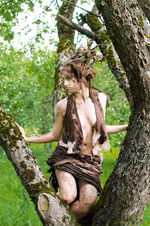 Dryad sits on the branches of an old tree