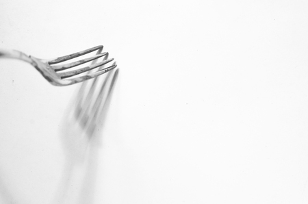 fork and the shadow of her background Stock fotó