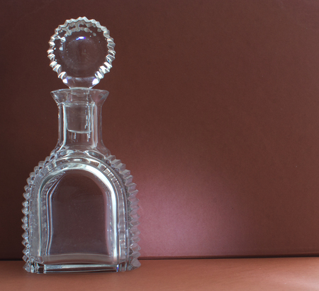 carafe with iron lid on vintage background