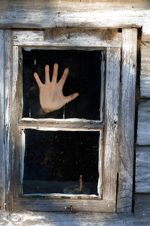 scary frame. hand out of the darkness as hand glass Stock Photo