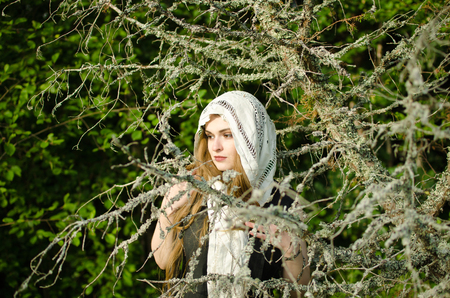 woman, perhaps a witch in the woods - portrait