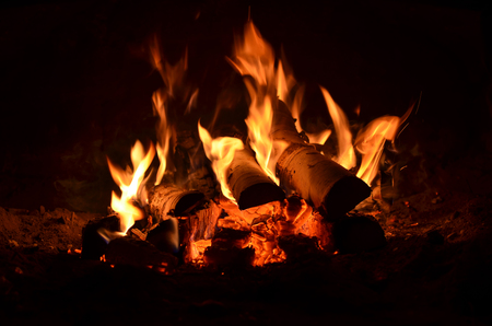 hot flaming wood in the hearth close-up-background image Stock fotó