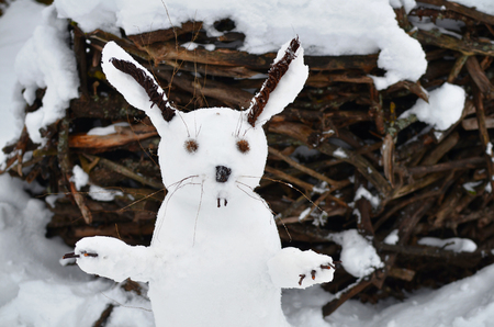 snowman in the shape of a hare. snow new year hare