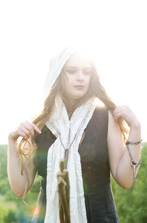 portrait of a young peasant witch in an old necktie illuminated by the sun