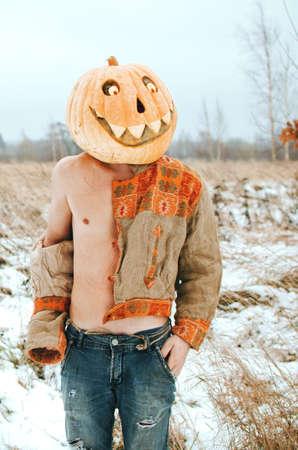 sexy Halloween pumpkin in the field