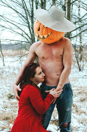 witch and a Halloween pumpkin kiss