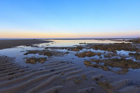 Sunrise at low tide on empty beach near Puerto Penasco Mexico.