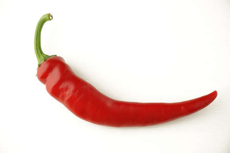 beautiful ripe big red hot chili pepper with a green tail on a white background Imagens