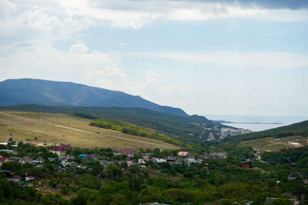 beautiful view of the Sukko valley, the sea, mountains covered with relict juniper and the sky with beautiful clouds on a warm summer day