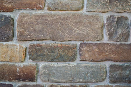 an element of masonry wall of unusual brick as a background