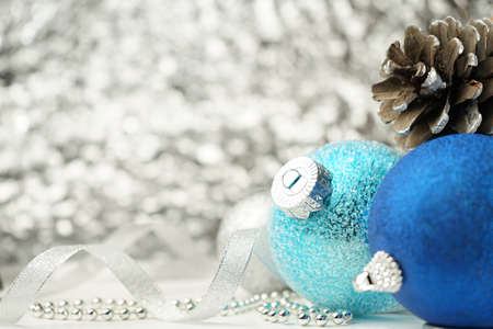 Christmas card with Christmas tree toys blue and silver balls, pine cones, ribbon, beads and Copy space