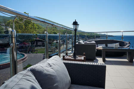 beautiful view from the summer terrace of the cafe to the embankment and the sea