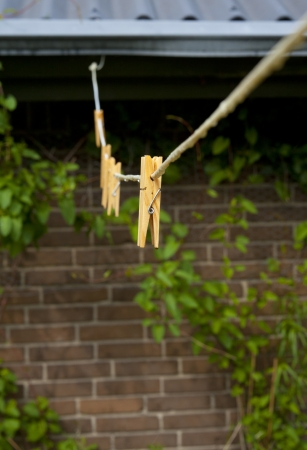 Wooden Clothespins on a Wet Chlothesline