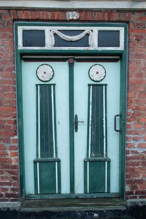 Old Colorful Green Door in Ribe, Denmark Editorial