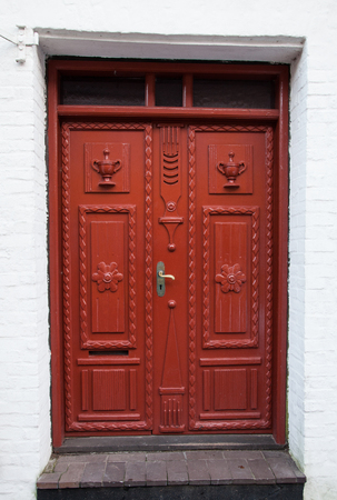Old Colorful Red Door in Ribe, Denmark photo